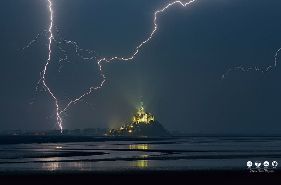Summer 2015.  Stormchasing in the Mont Saint-Michel / France. A stormchasing unforeseen during my Breton road-trip where I visited all the castles-forts of Brittany.  This evening I was able to make this photo with two different angles. A unique photo which a lot of people tries to equal — feeling cool in Mont Saint-Michel.
