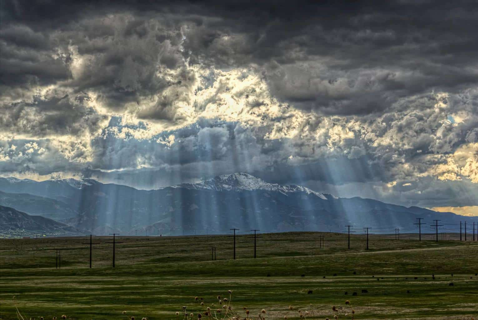 Sun rays draped Pikes Peak in Colorado Springs as a storm was building in strength. 05/26/2017