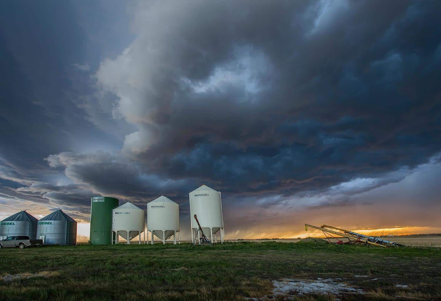 I got home to Leader Saskatchewan from a 20 day trip to tornado alley, 14,300 kms driven (8900 miles). Chased storms twice today, this was round 2 right at sunset, right by Leader.