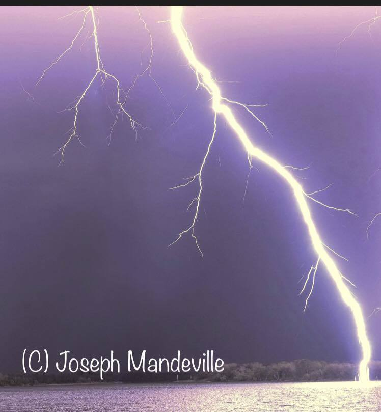 Lightning so close you can see the streamers on the waters of St Andrews Bay in Panama City Florida