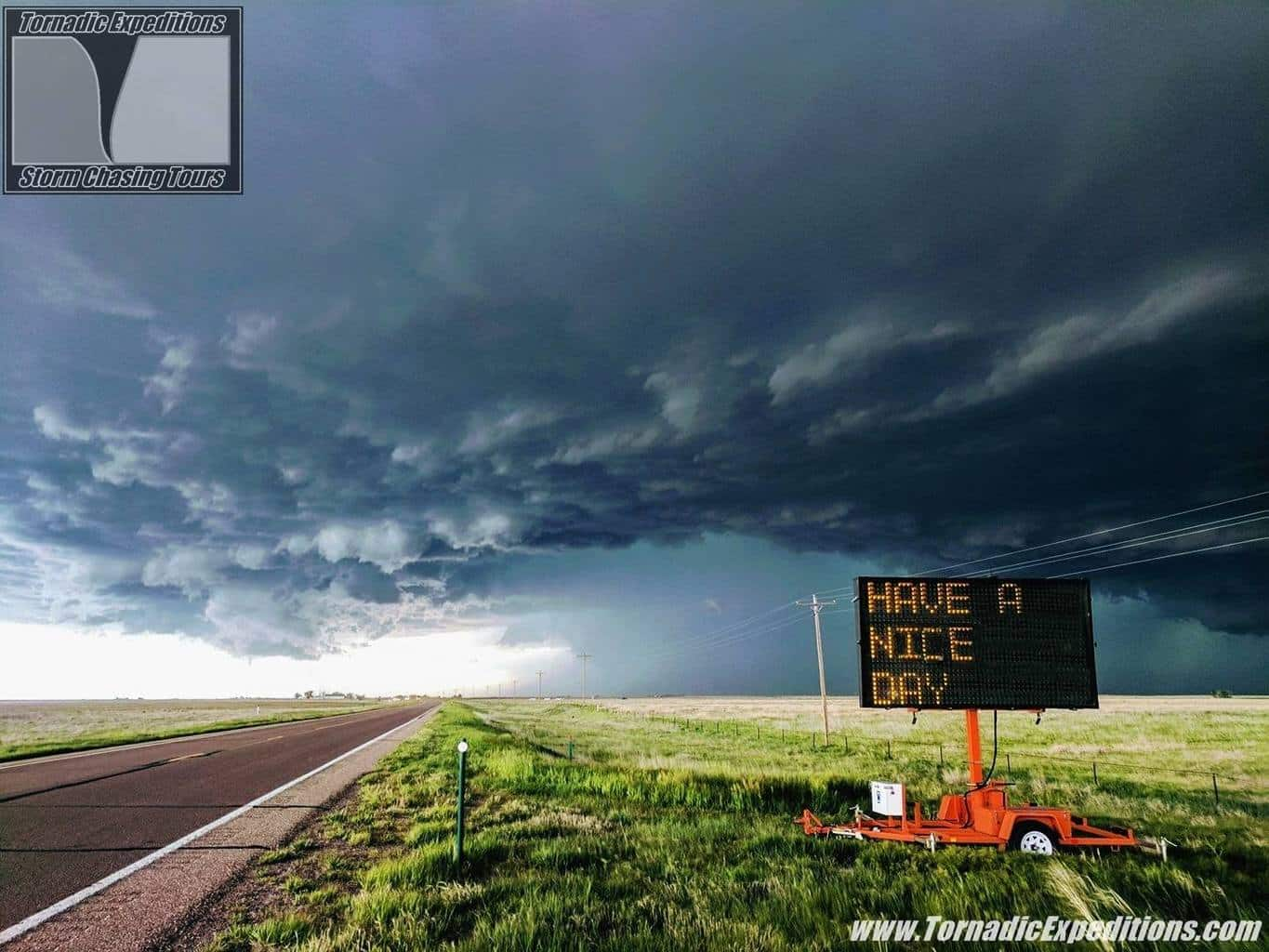 """Tour- 4 chased two days in a row in Colorado. On the first day we drove by this sign and we all laughed how cool it would be to get a storm behind it. Well on the second chase day it happened! Near Joes, Colorado 05/26/17. """"Have A Nice Day"""""""
