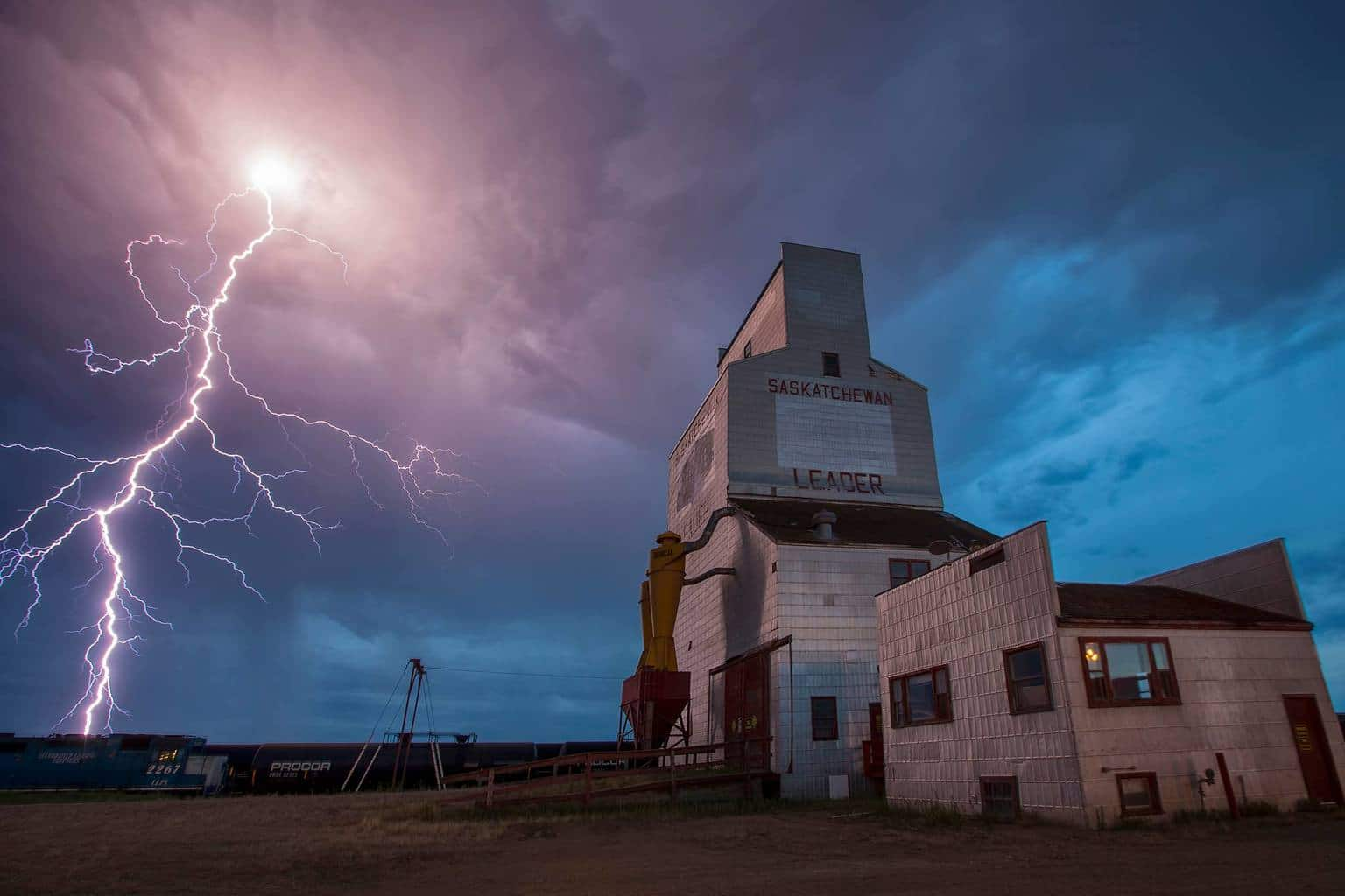 Bucket List Shot! I did not go storm chasing today, but said I will wait for them to come to me, and hope they still have lightning in them. 9 hours later, I took my mom out to watch the storm. I set up my camera at the last standing grain elevator in Leader Saskatchewan, where I have lived for 37 years. 30 pics into the 3.2 second exposures, this happened!! It has been my dream capture for years, and tonight it finally happened!