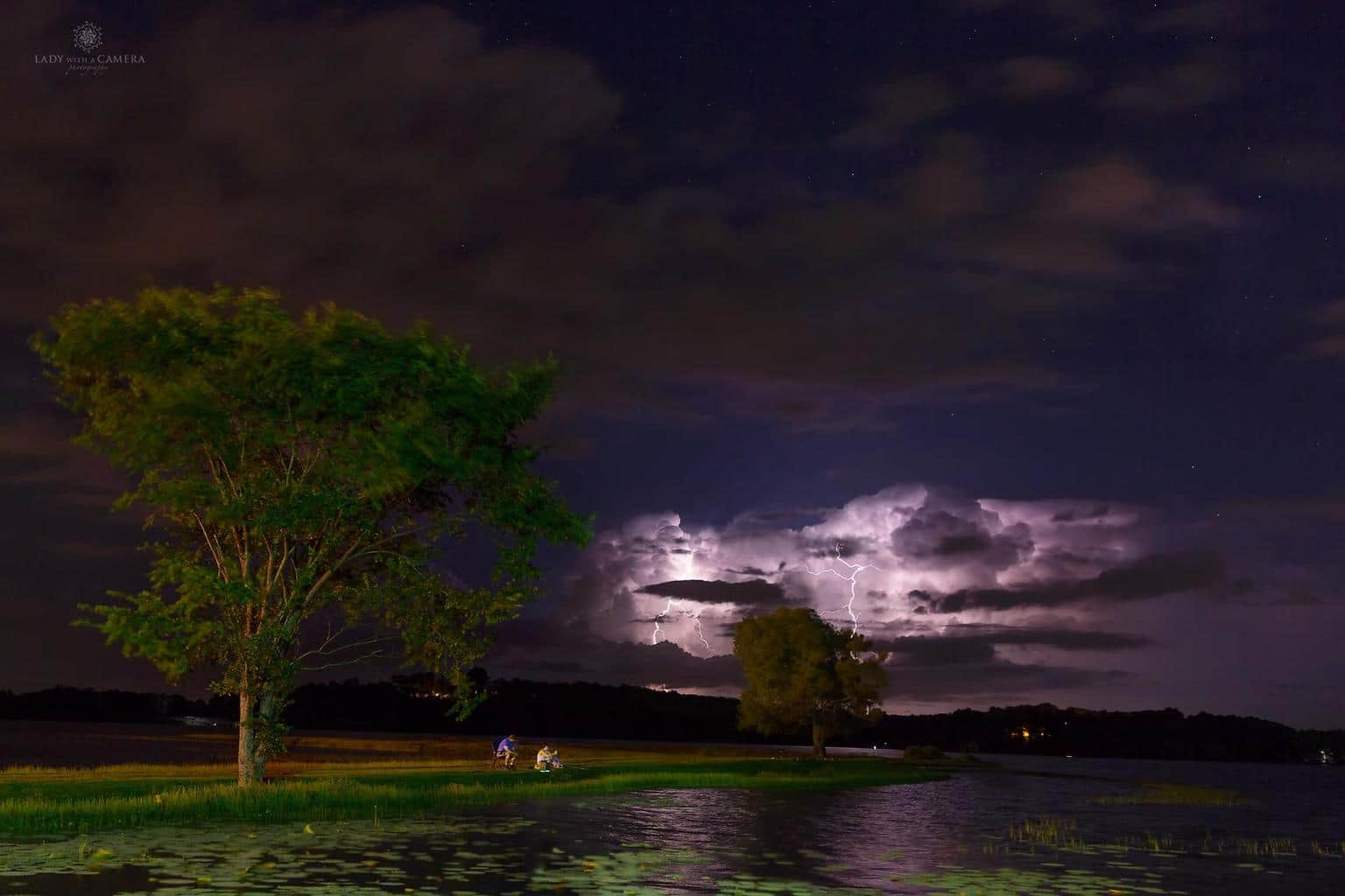 When the fish are biting you keep fishing. Lightning and stars light up the sky over Lake Beaverfork last night in Conway, Arkansas.
