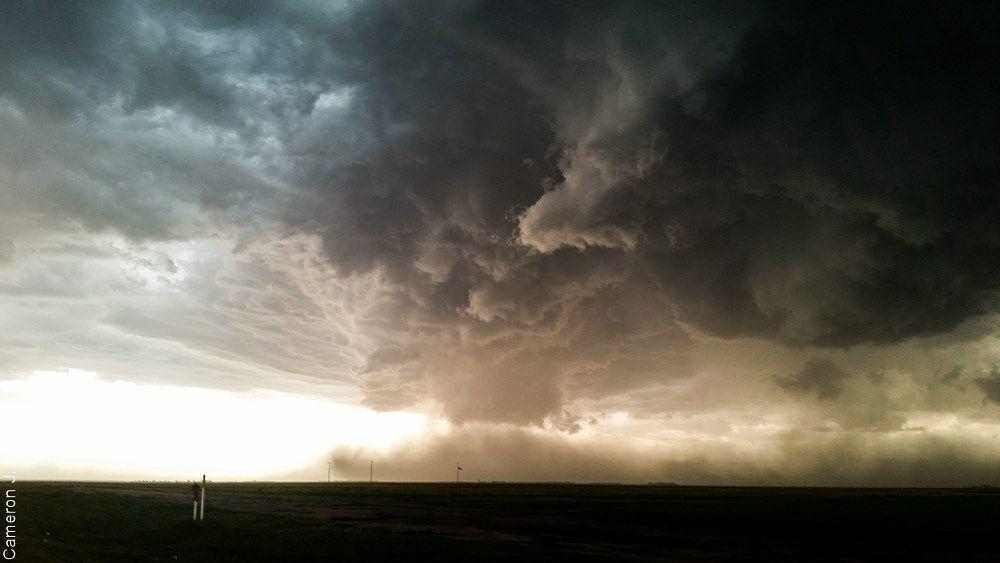 Dueling tornadic circulations dance in the dust toward Oakley, KS.