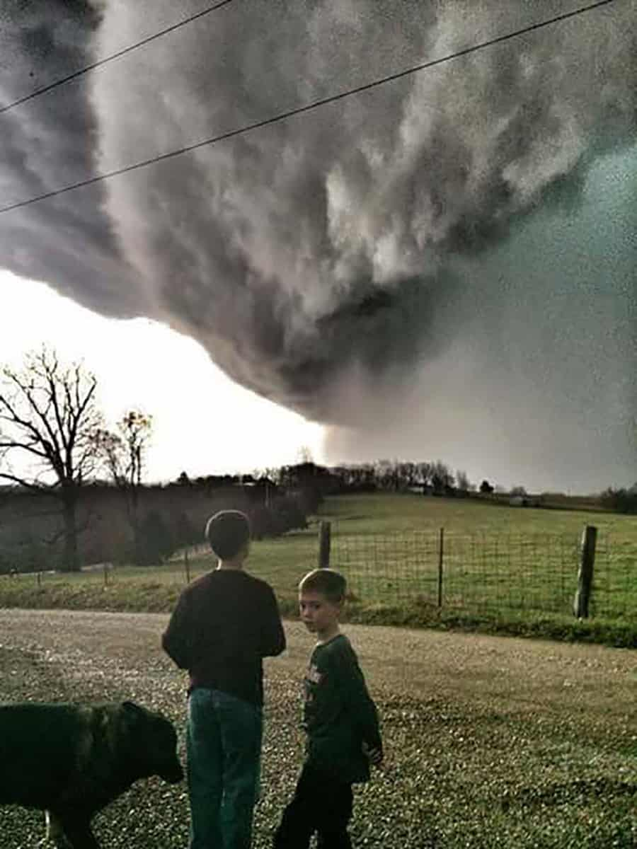 Storm near Camdenton Missouri . Future storm chasers. I stopped near there house to get this photo. I don't know who these children are but they was just as fascinated by the storm as I .