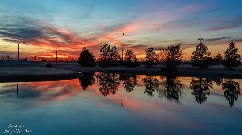 After the sun sank below the horizon, the muted colours bloomed across the sky and were reflected in a local pond. Hillsboro, Kansas