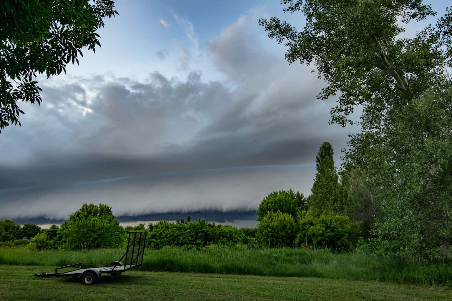 When you spot a beautiful shelf cloud sneaking up in your back yard. LeMars Iowa June 2016. I have several awesome shots. This was the first shot.