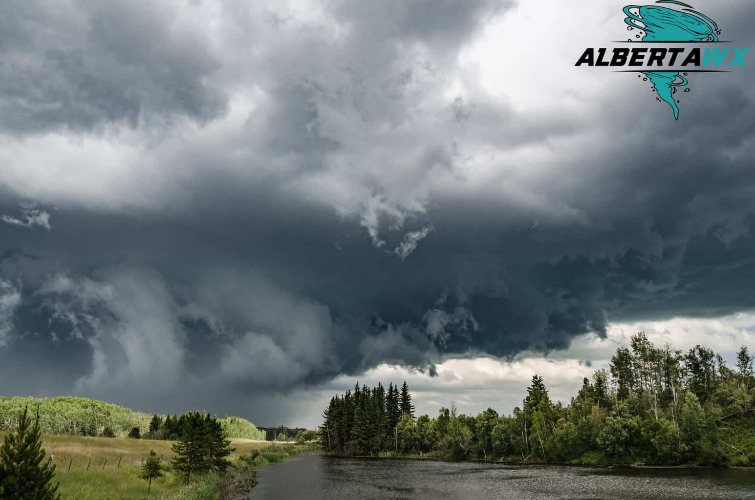 Violent HP supercell hovering over a small lake near Ponoka, Alberta July 23 2017. Tennis ball sized hail, flash flooding, and damaging winds.