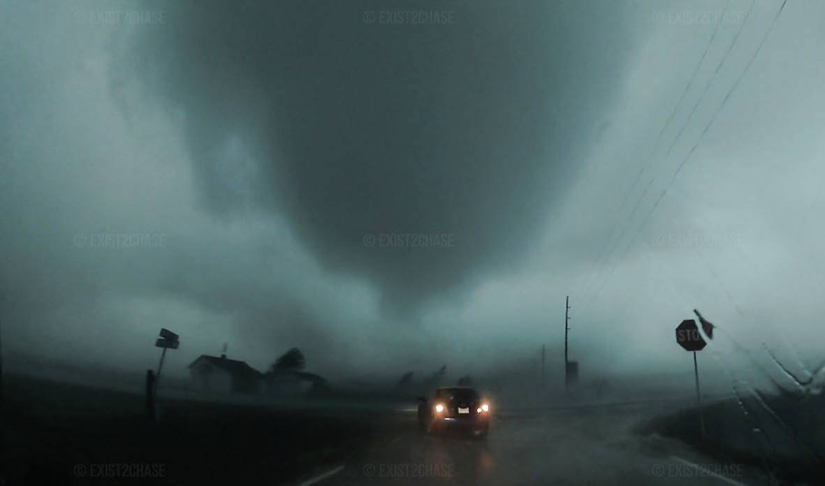 UP CLOSE AND PERSONAL: EF2 Cone Tornado in Clearwater, Kansas on May 19th, 2013.Exist2Chase. This was quite a trying chase with a few tornadoes in very tough conditions. Most tubes were wrapped in rain which was quite the challenge and you virtually had to be positioned within the RFD wrap to actually see. This particular tornado was hitting a house around 90 yards away at the time of this image and we were virtually within the outer circulation of the tornado.