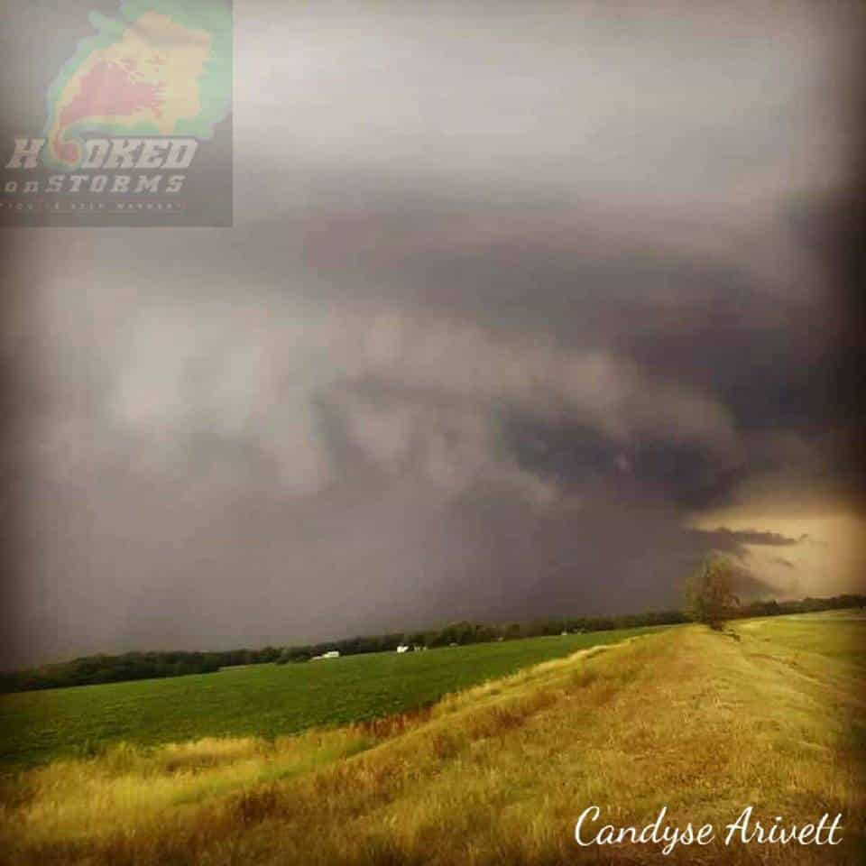 July 11th of last year my boyfriend, Eric Lawson, and our friend Brandon Oboikavitz traveled from Indiana to North Dakota with hopes of finally witnessing the storms of the northern plains and did mother nature really show off! She produced this beauty! This photo was shot not far away from the town of Hillsboro, North Dakota. We sat here and watched this supercell spin until we noticed the left edge was coming straight for us near the Taft Elevators in Hillsboro and we had to flee! This supercell produced a EF2 muti vortex rain wrapped tornado with peak winds of 135 miles it destroyed many farm buildings and snapped many trees in half.