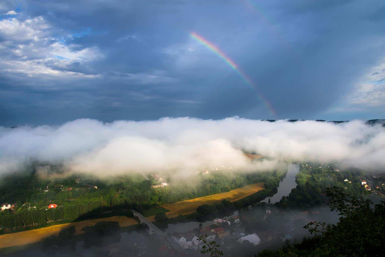 Valley fog, anti-crepuscular rays and rainbow, Czech republic, 10th July 2017