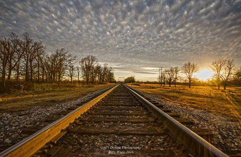 Sunset and Altocumulus and a long set of railroad tracks are lovely.