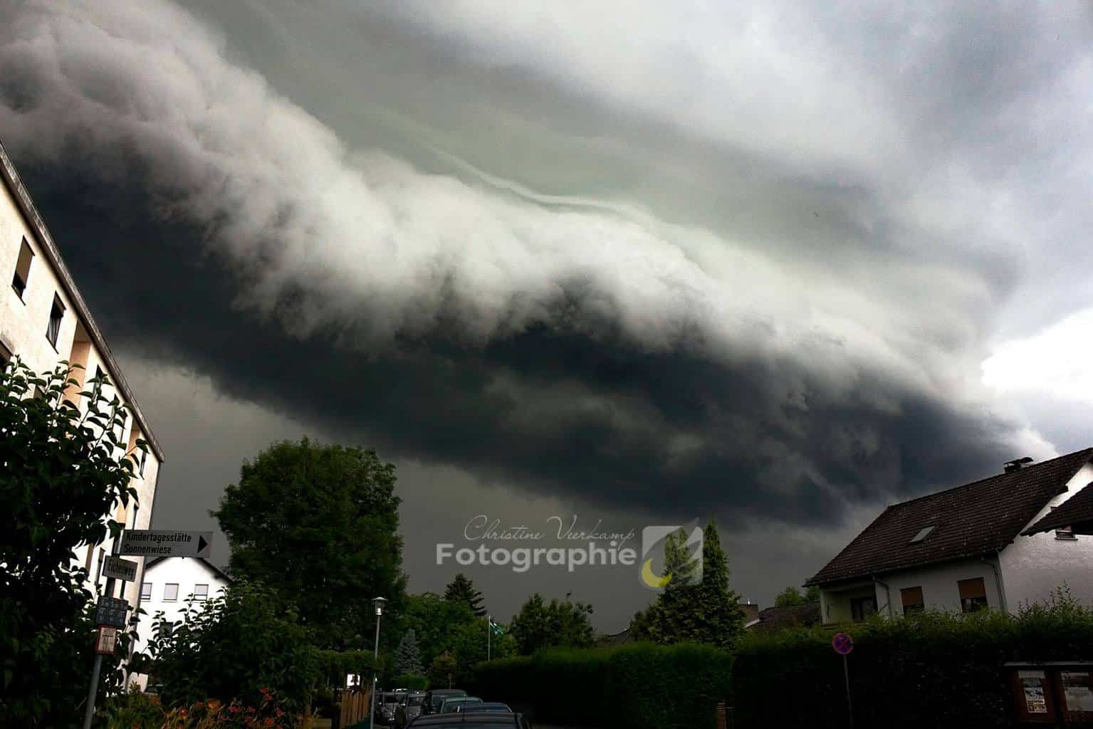 The Wall - 29th June 2017 - Germany When you out for shopping with your relatives in the Area near and notice a massive Storm with a non rotating wall cloud in distance clouds move upwards in massive tempo while you sit in the Car on large parkdrive of a Shopping Center and cant move .....your excitement rise.Cant wait to go home or stay ahead of it ... 10 min later a long line of shelf cloud forms....we drive home get ahead , not to get overrun by the rain and possible Hail ,the cloud almost crawls over the horizon and almost home the Sky has become dark grey and cloudy scuds.The Tempo had suddenly rised. At home run like the wind upstairs, grab my still cam, downtairs again ...and i got this incredible Image. Call it a unexpected Stormchase.