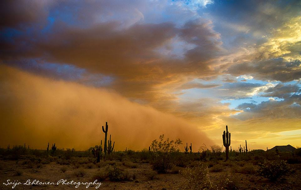 A dust storm meets the sunset during a monsoon storm in Arizona.