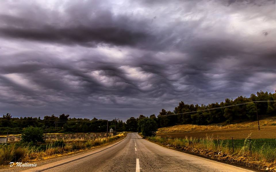 Undulatus Asperitas clouds above Pissonas area on Evia island Greece. I saw this type of clouds for the first time, although in my area often similar impressive atmospheric phenomena are created, especially in the spring and autumn. The clouds remained on the sky for a few minutes only and then dissolved. The photo was taken on May 6th 2018 at 17:48 local time.