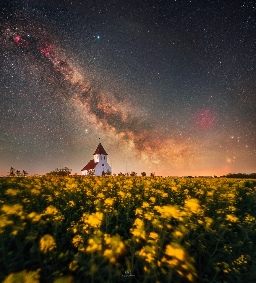 Fading Milky Way over the blooming canola field in Agerø, Denmark. Canon EOS 6Da + Samyang 24mm f/1.4 + iOptron skytracker Sky: tracked and stacked panorama (total integration of each frame is between 7 and 20 minutes) @ f/2 and ISO 1250. Foreground: 3-shot panorama @ 30 seconds, f/2.8, ISO 3200.