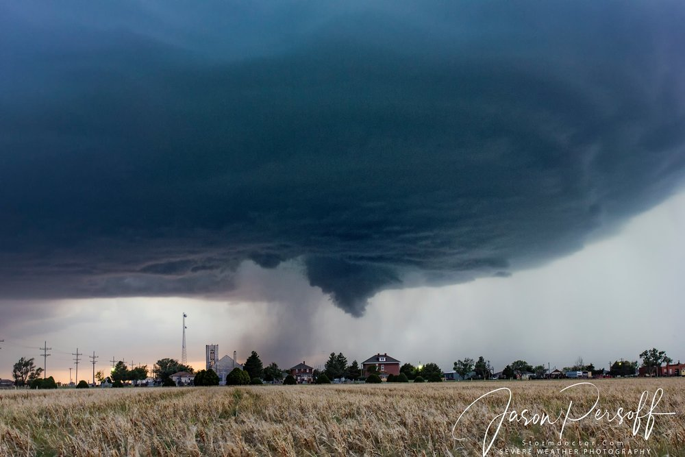 On May 18 east of Quinter, KS, we came very close to a tornado. Here this amazingly photogenic storm hovers over Collyer, KS, rotates over the church and city buildings.