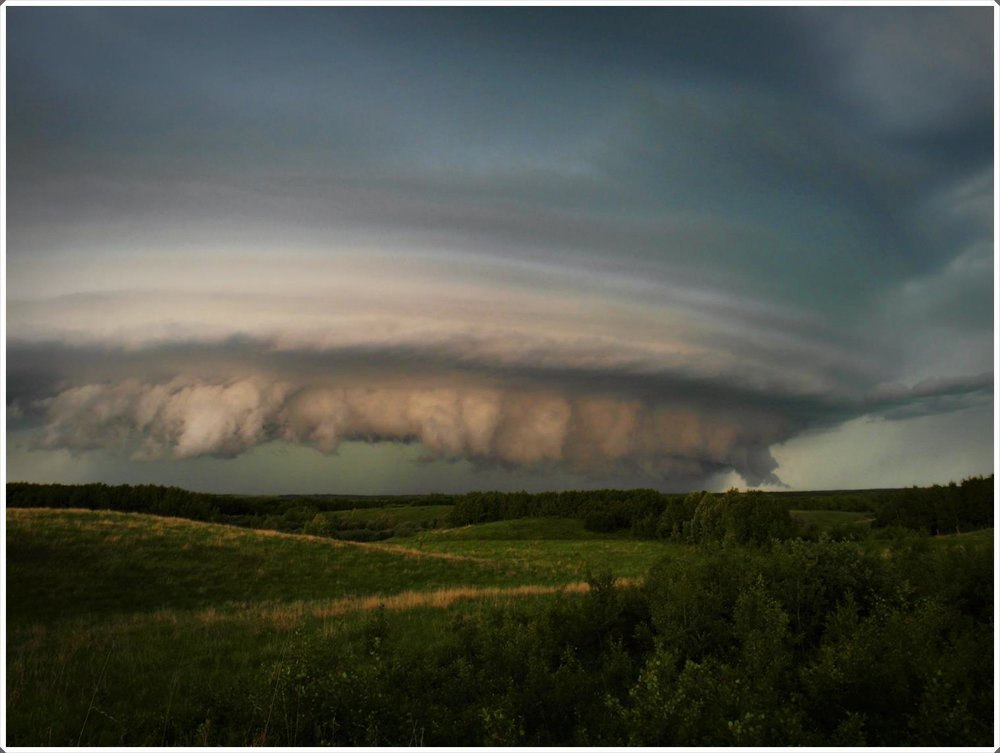 Teeth 2018 June 9th, 8:45PM Near Unity Saskatchewan Canada  It was so eerie and surreal to watch this shelf cloud slide across in front of me in a familiar spot close to home this past weekend - It was so misleadingly calm at my vantage point! — in  Baldwinton, Saskatchewan .