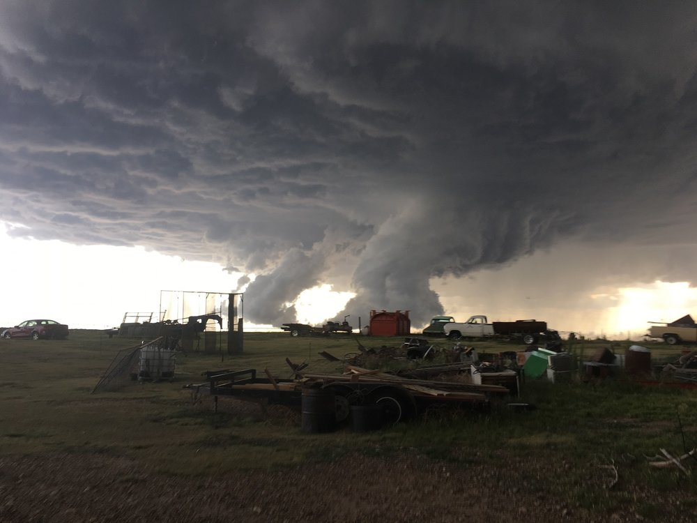 My mother took this photo just a couple of minutes before they issued a tornado warning for Morton County in Kansas tonight. (About 6:18pm CST) This is about 4 miles south of Rolla, Kansas facing towards the Southwest.