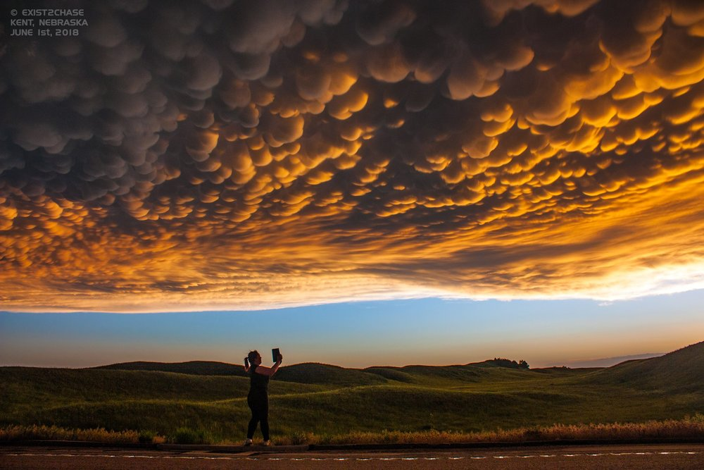 My wife Kylie's first time chasing storms in the US this year with me and she had an absolute ball! This is one of my favorite photos of her capturing a spectacular panorama of a mammatus sunset in Nebraska over the sandhills. June 1st, 2018 just to the north of Taylor, Nebraska. Facebook: Exist2Chase Twitter: @Exist2Chase.
