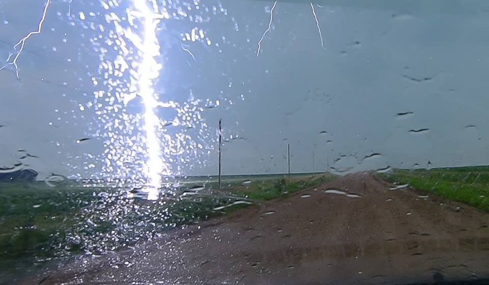 Very close lightning this morning North of Oyens Iowa while taking a video through my windshield in heavy rain.