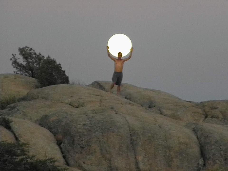 My roommate took a picture of me holding the moon. I call this I got the whole moon in my hands .this was on June,27,2018 here in Prescott Arizona