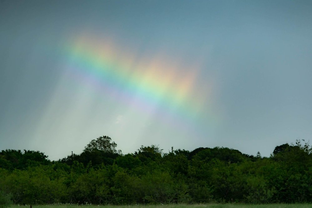 From earlier this month, this piece of sky with an unusual piece of rainbow. Texas.