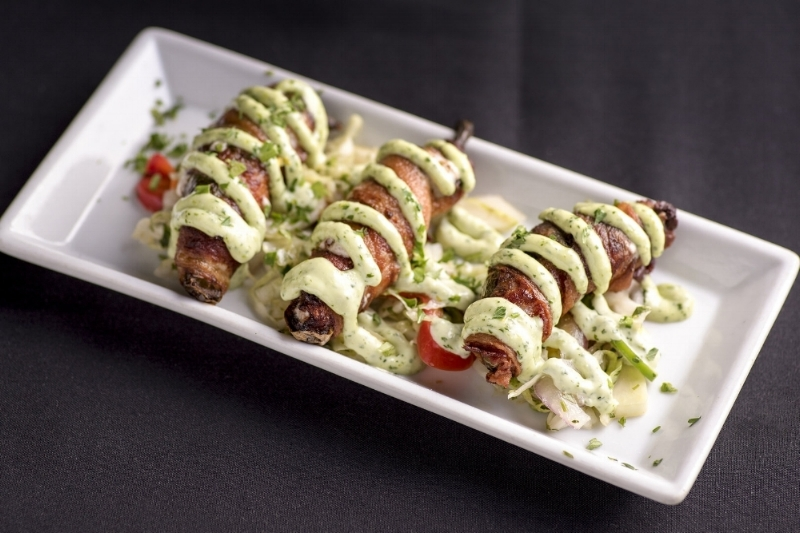 FILET STUFFED JALAPENOS - bacon wrapped, herb cream cheese, cilantro aioli, spicy cabbage slaw
