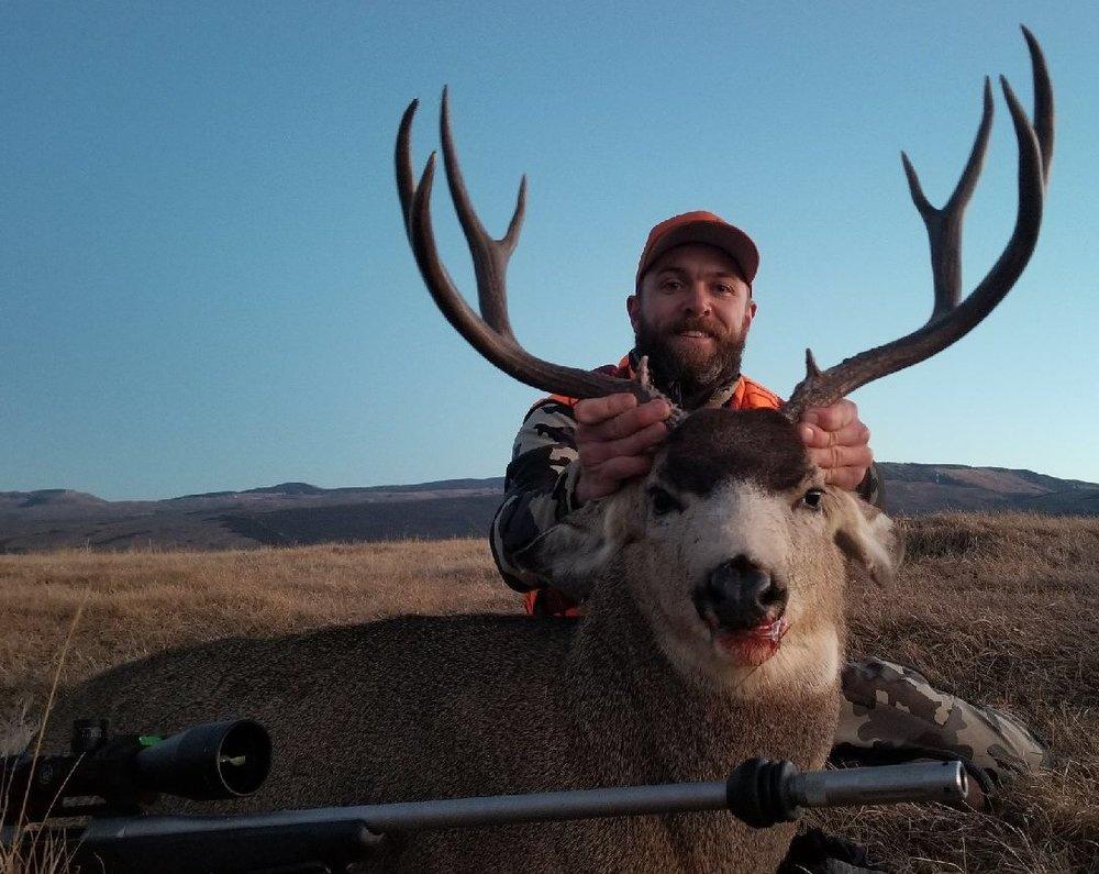 Evan T and a nice mule deer buck.jpg