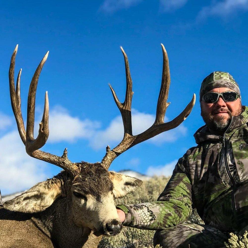 Mike D and a big colorado mule deer buck.jpg