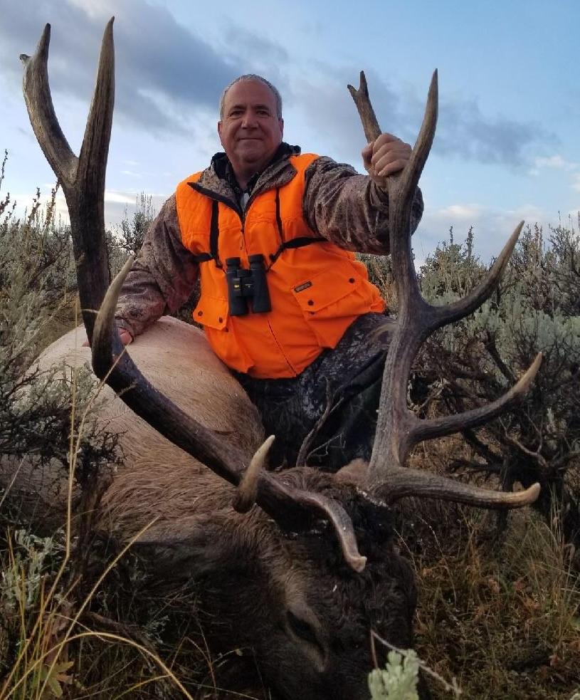 Scott Shrader and his heavy horned Bull elk.jpg