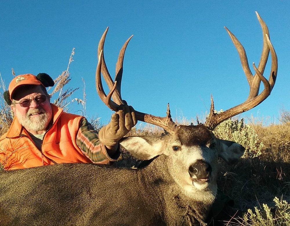 Starr and his trophy Colorado mule deer.jpg