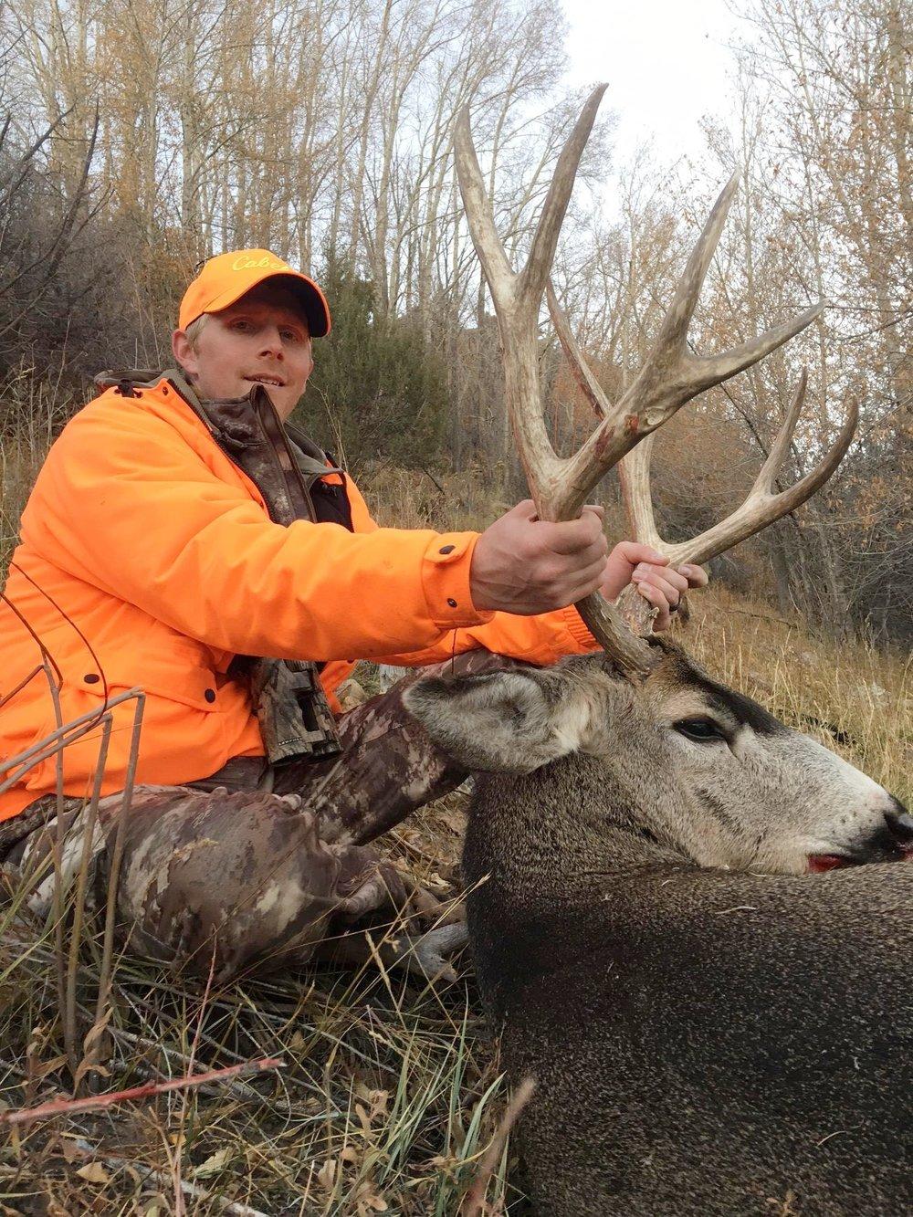 Todd m and his Bull Basin mule deer buck.JPG