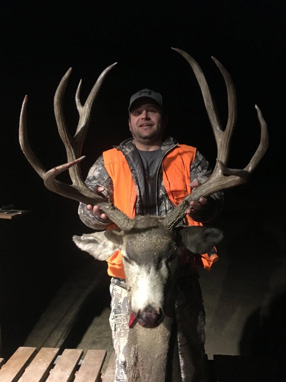 Casey and his boone and crockett mule deer buck.JPG