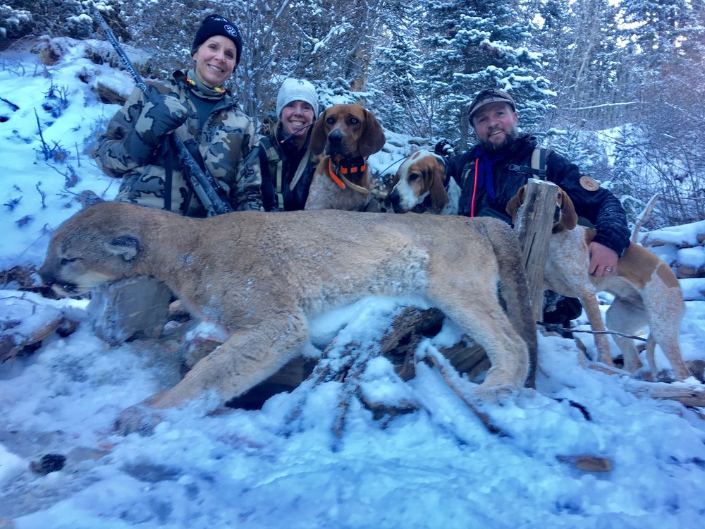 The crew with Susan's trophy tom mountain lion.jpg