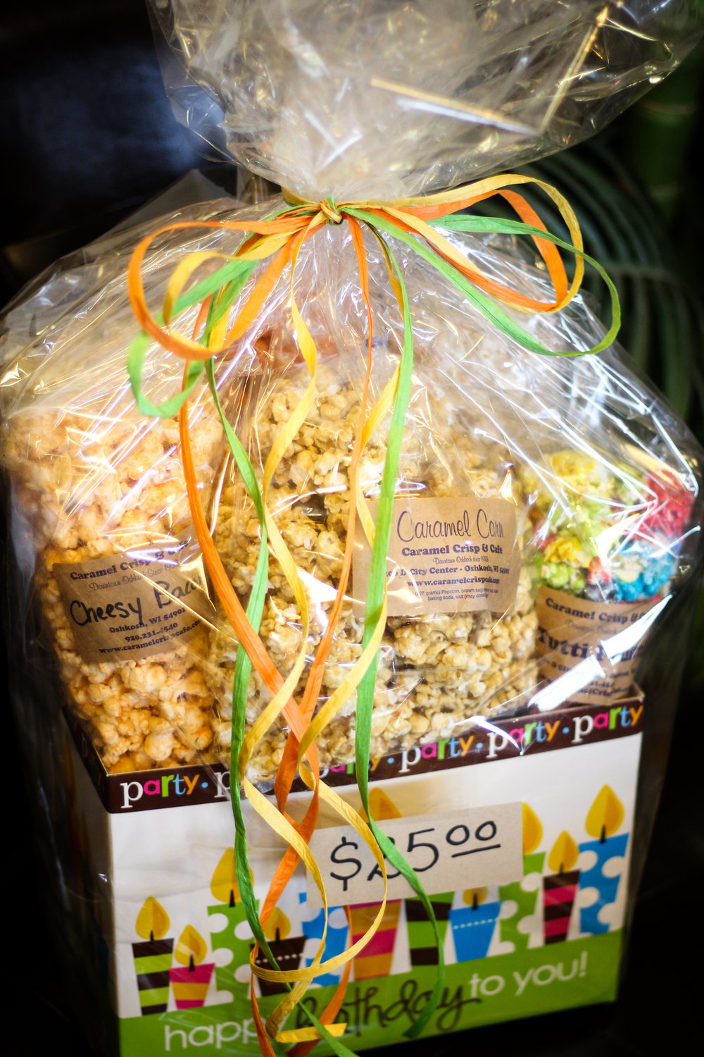 Call (920) 231 - 4540 to order your popcorn tins or gift basket today!