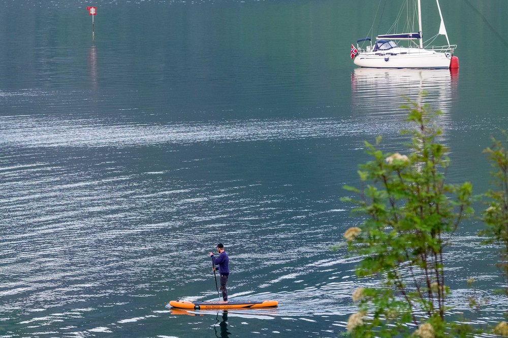 Helleik going for a trip on his SUP in considerably calmer conditions