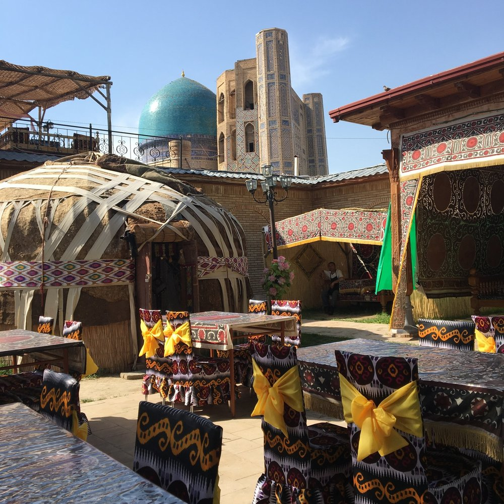 An open air  chaykhana , or teahouse, in Uzbekistan