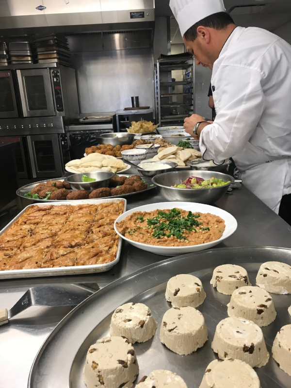 Chef Alex putting the finishing touches on our contributions to the family meal