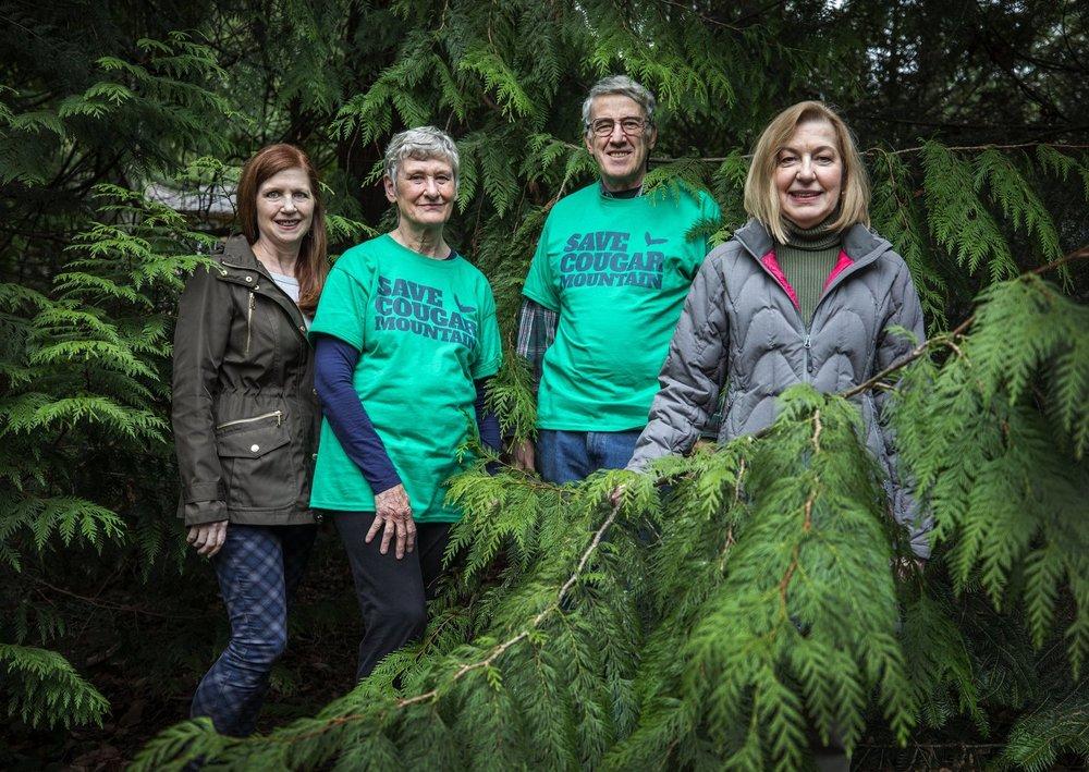 Save Cougar Mountain Activists (L to R): Julie Clark, Kay Haynes, David Kappler and Susan Neville. Photo: Steve Ringman/The Seattle Times