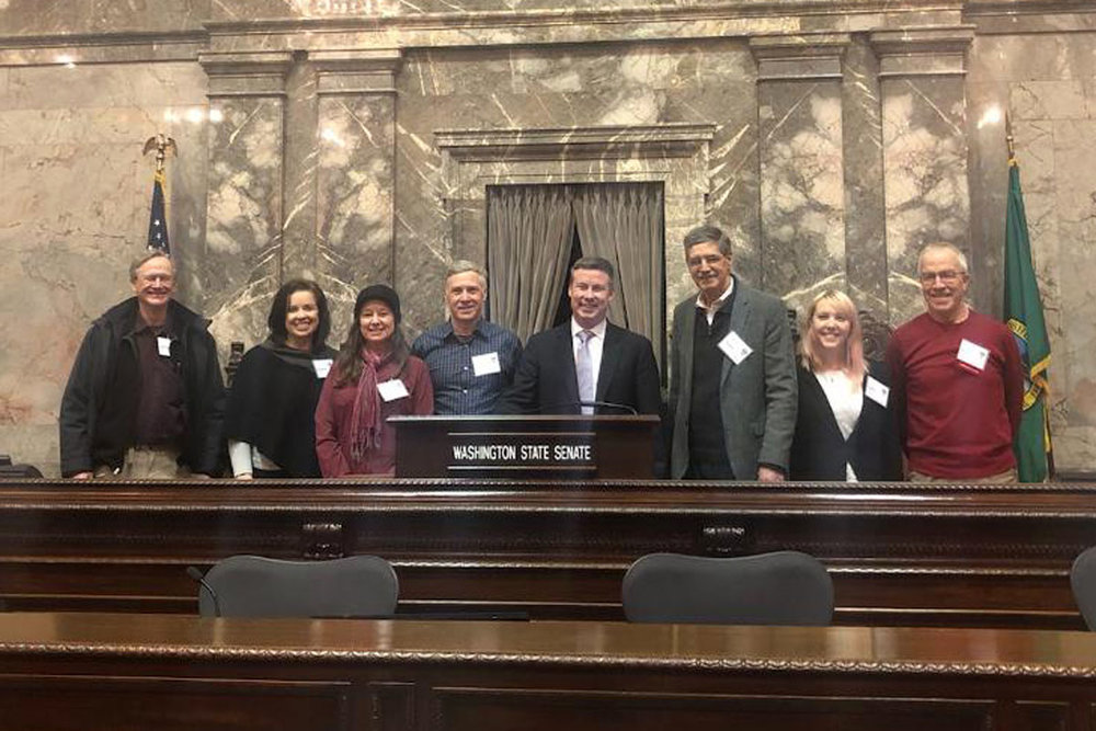 The District 5 sub-group (covering east King County towns like Issaquah, Maple Valley, Snoqualmie, North Bend, etc.), meeting with state Senator Mark Mullet. The senate was not in session, so we were lucky to take this photo in the senate chambers.