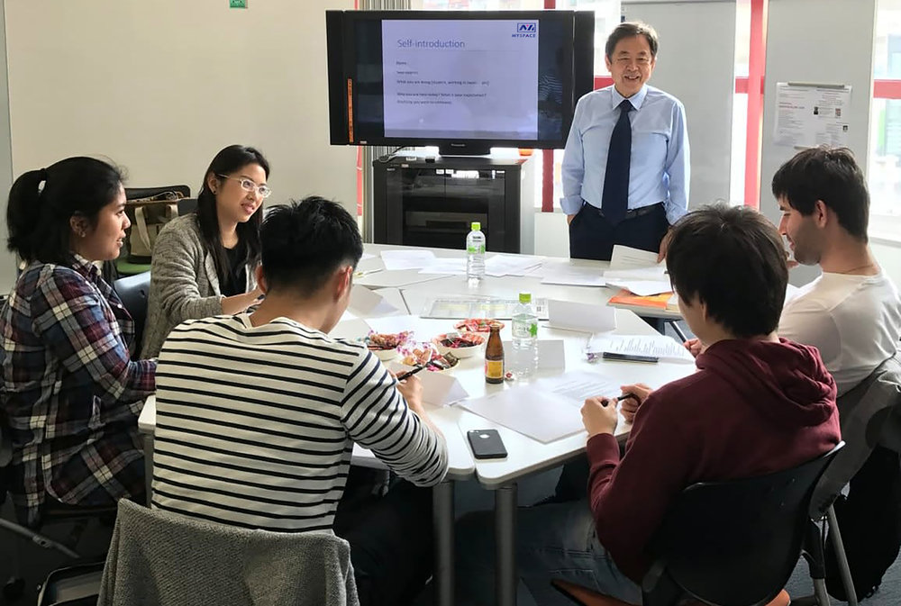 A Japanese professional is teaching some young people Japanese, and how to introduce themselves in the culture before they visit companies in Japan.