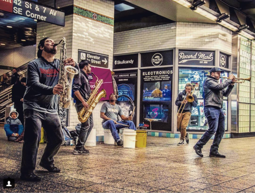 Drumadics Beat-N-Brass Band_Official Times Square Action Photo.png