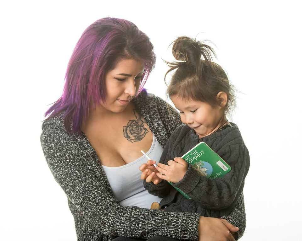 Mother reading to daugter