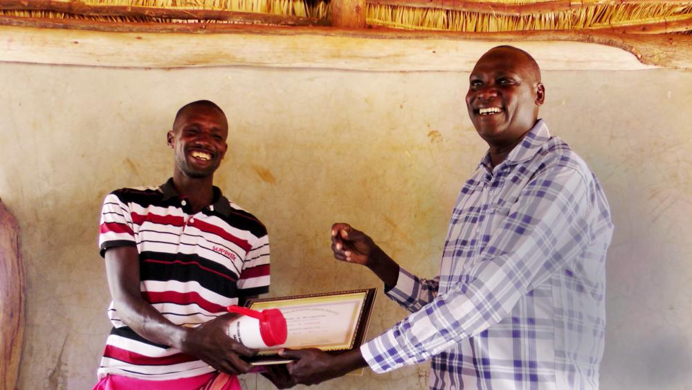 Lomuria N'alekirion with NRT's Samburu County Director Titus Letaapo