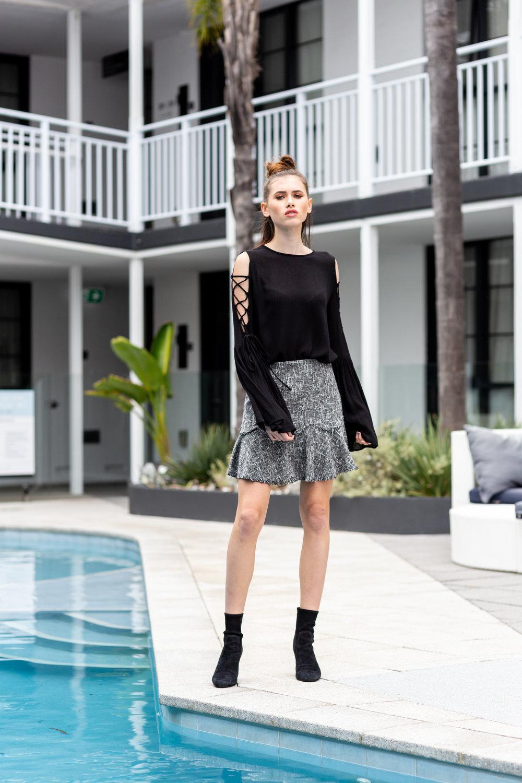 Desiree wears:  Sleepless Bell Sleeve Top , Clueless Skirt & Demi Suede Boots .