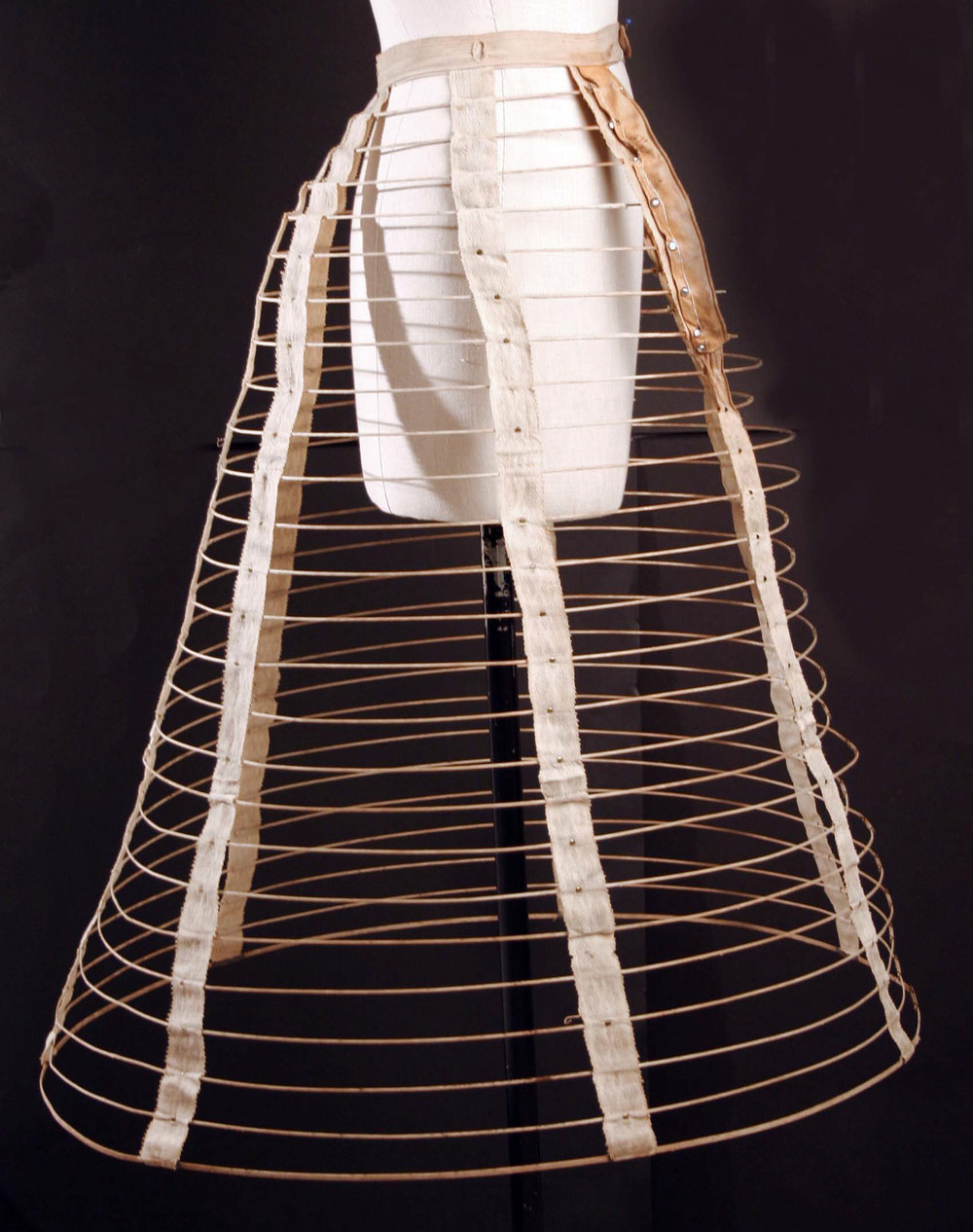 Hey there, cage crinoline! This 1860s number is made from metal wire, cotton tape, and a touch of leather. The hoops of cage crinolines could be made of whalebone, cane, or steel - that last became quite popular when factories started making them mass assembly style (aka cheaply). These crinolines meant that girls could achieve the desired volume in their dress without having to wear a million layers. It also meant that they could dance, squat, and air things out a little with relative ease. Hurrah!   Courtesy The Metropolitan Museum of New York, Purchase: New York Historical Society (by exchange), 1985.