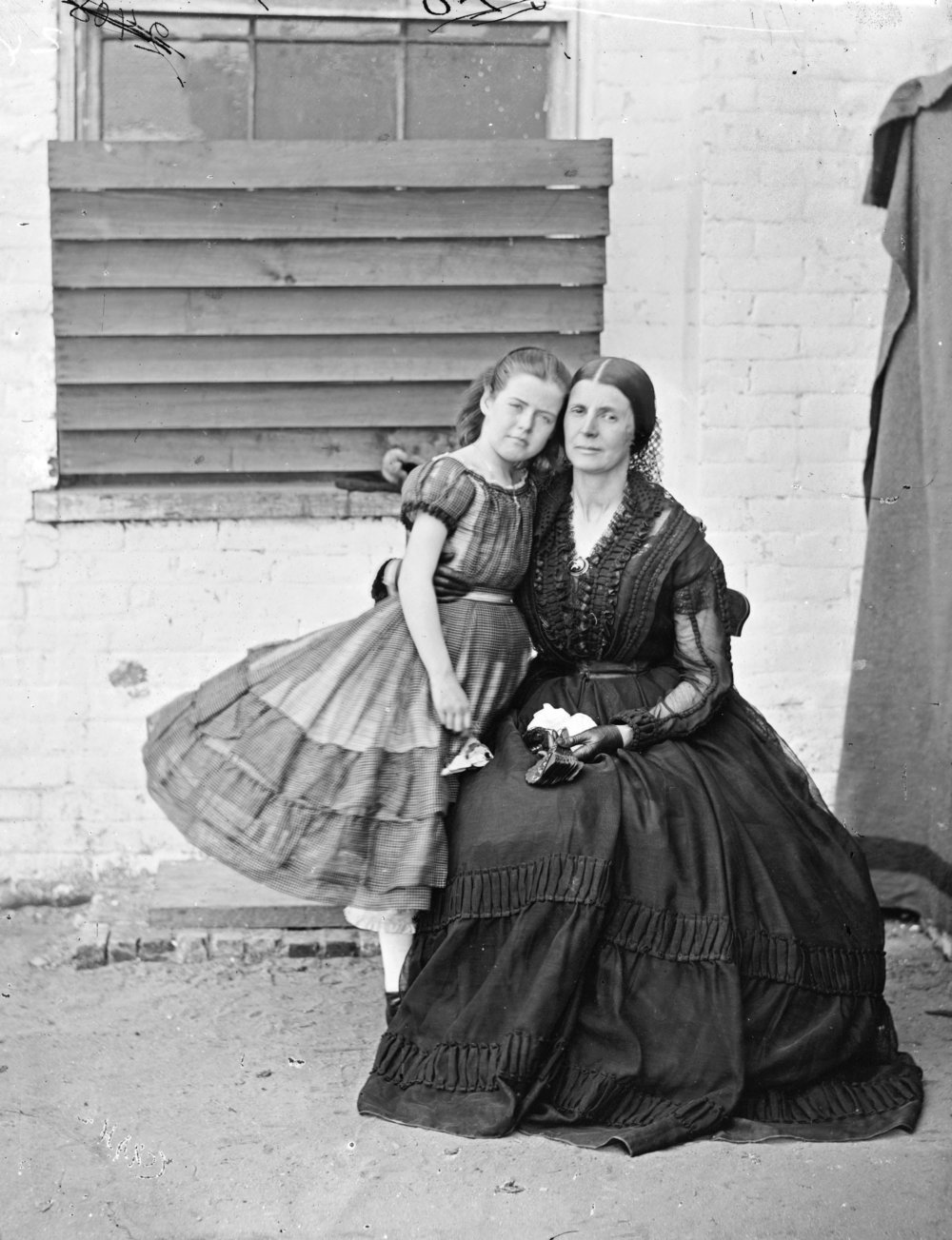 A portrait of Rose and Little Rose, having a little outdoor exercise at Old Capitol Prison. At least they were still able to do their hair?   Wikicommons