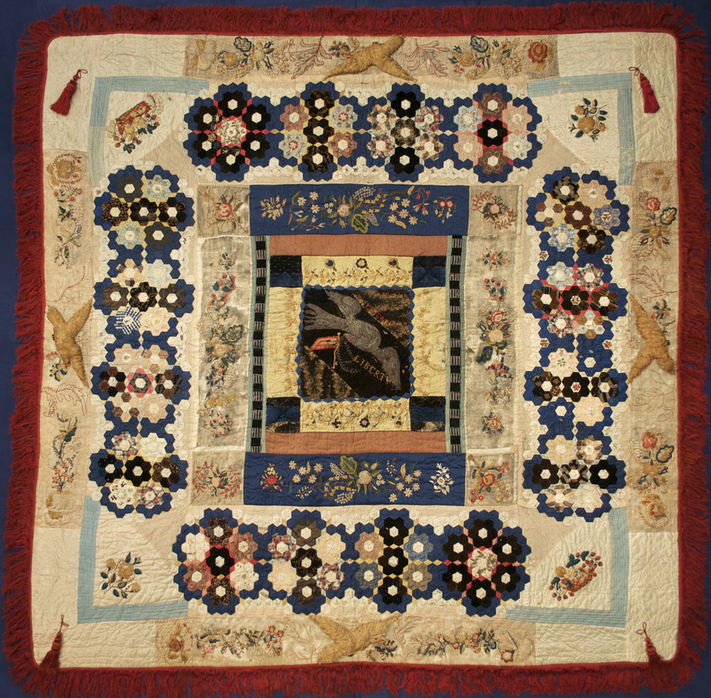 This quilt is attributed to Elizabeth Keckley, made between 1862 and 1880, after Lizzie bought her freedom. It's made out of scraps of silk, which she probably pieced together with remnants of her clients's dress materials. As such, it's likely that some of these scraps were once Mary Lincoln's.   Courtesy of Kent State University Library.
