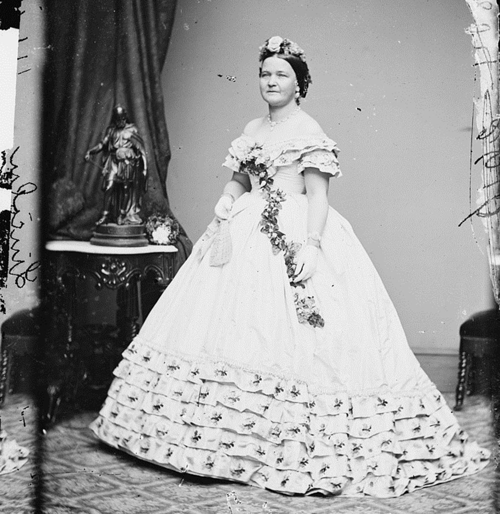 "Mary Lincoln, all flowers and cleavage - and looking classy as hell. All thanks to her ""best living friend"" Elizabeth Keckley. Being a First Lady then, as now, was all about appearances. A dress could say a thousand words, and though Mary had a lot of haters, they had to admit that her dresses were dope.   Wikicommons."